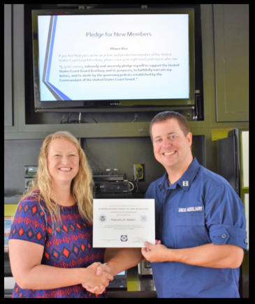 Gini with Flotilla Commander and Certificate